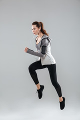 Vertical image of sports woman running