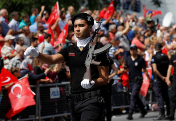 A Turkish riot policeman marches during a ceremony marking the 95th anniversary of Victory Day in Istanbul