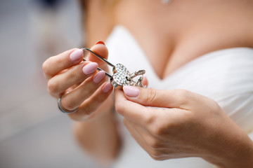 Padlock of love in the hands of the bride