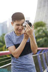 Young photographer focusing on his subject