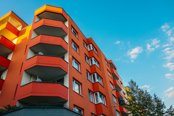 red corner building with big balcony
