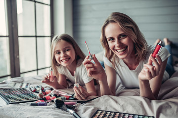 Mom with daughter doing makeup