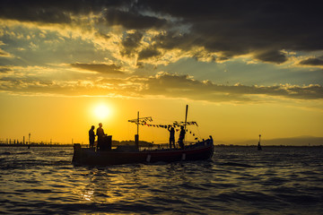 Sea sunset image. silhouette of the boat on summer sunset background.
