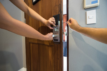 locksmith team fix smart lock on wood door