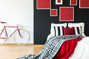 Minimalist bedroom with red bike