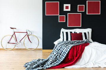 Red bike against white wall
