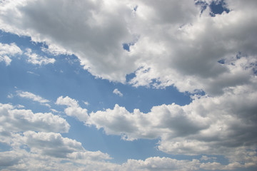Blue sky with clouds on sunny day background
