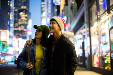Young asian couple looking around in Times Square