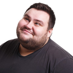 Lost in thoughts, smiling fat man with thoughtful face