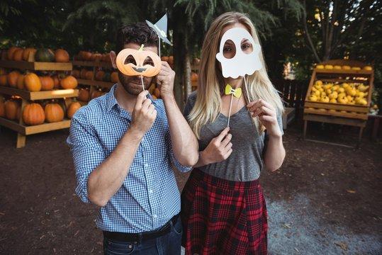 Couple wearing halloween mask