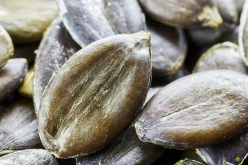 Extreme close up picture of pumpkin seeds, shallow depth of field.