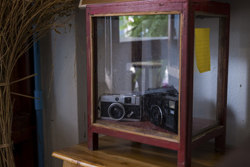 Vintage film camera in the wooden show case