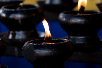 sacred fire, coconut oil lamps in a buddhist temple from Thailand