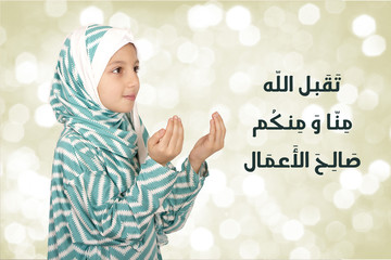 Cute Little Muslim Girl wearing hijab - making duaa ( praying to Allah )