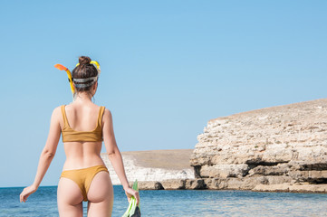Beautiful girl in accessories for diving on the background of the sea. High quality