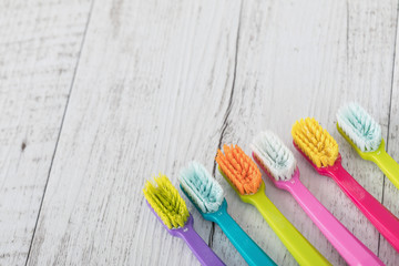 New and used color ultra fine toothbrushes in colorful glasses. Dental Industry. various types of toothbrushes. Beautiful smile concept. Whitening. Tooth care. Teeth healthy concept.