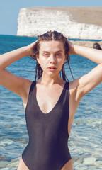 girl in a bikini on a background of the sea