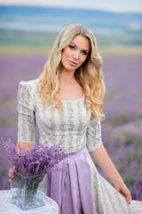 Woman walk in the field of lavender