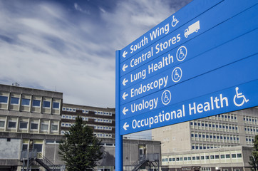 hospital and sign giving directions to different departments