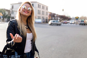 Beautiful young woman walking in the street