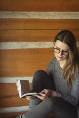 Woman in spectacles reading book