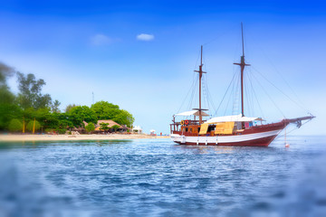 old wooden sail boat in a beautiful Bay. Water transport