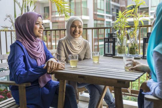 3 Girl-friends having a conversation over tea
