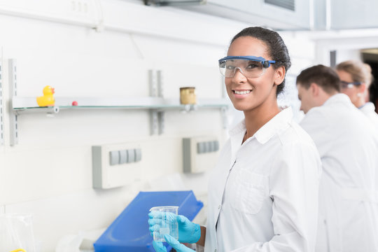 Female lab technician with safety goggles in laboratory