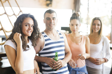 Group of friends having a drink at day party