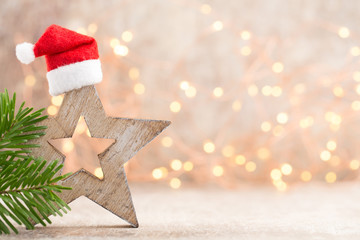Christmas stars decoration with santa hat. Vintages background.