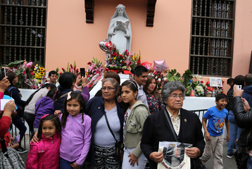People take pictures at Saint Rose's Church during celebrations of the anniversary of Santa Rosa de Lima (Saint Rose of Lima) in Lima