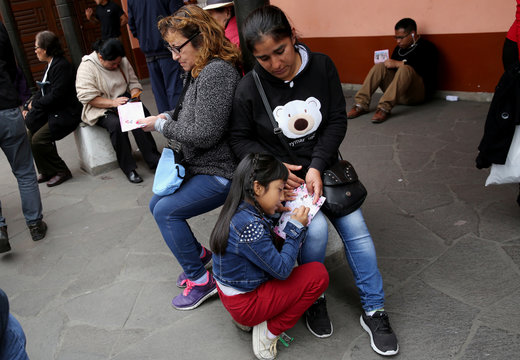 People write letters before throwing them into the well of wishes at Saint Rose's Church during celebrations of the anniversary of Santa Rosa de Lima (Saint Rose of Lima) in Lima
