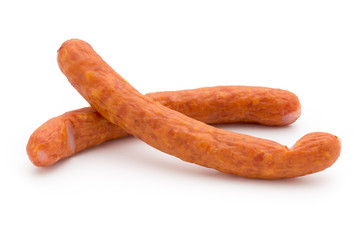 Stack of smoked sausages isolated on a white background.