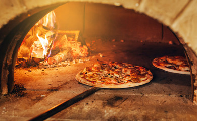 Zelfklevend Fotobehang Pizzeria Italian pizza is cooked in a wood-fired oven.