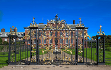 The gates of Kensington Palace in Hyde Park in London, England