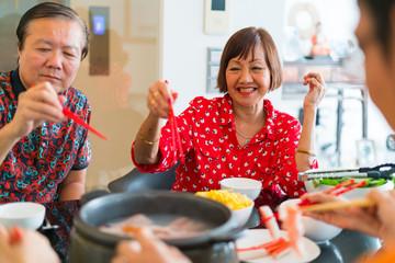 Cheerful grandparents on Chinese New Year