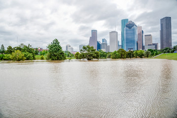 Downtown Houston at daytime with storm cloud sky and rare high water flood on Eleanor Park because of Harvey Tropical Storm. Heavy rains from hurricane Harvey caused many flooded areas in Houston