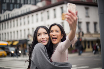 Young asian girls taking selfie in Meatpacking district