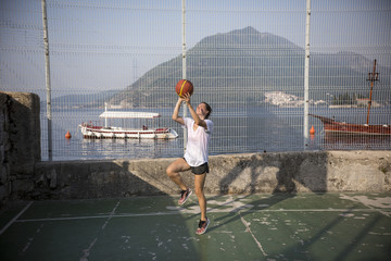 Professional female basketball player shooting