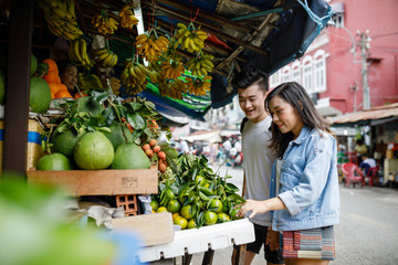 Couple Walking Through Local Market in Vietnam
