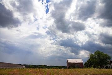 Abandoned farm with storm clouds