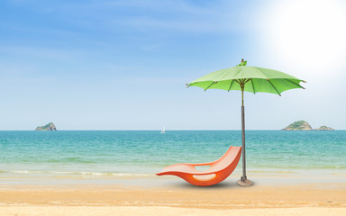 Beach chairs and with umbrella and beautiful beach on a sunny day