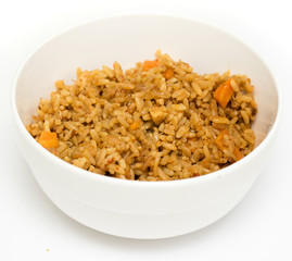 Rice boiled in a plate on a white background