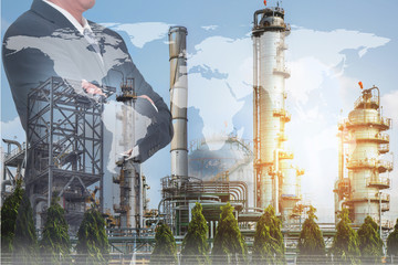 Double exposure of Businessman arms crossed and stand up, world map, Electric Generating, fuel oil Factory and Energy Industry plant as business, industrial and energy concept.