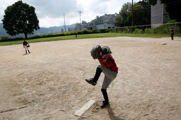 Xavier Indriago pitches during a baseball championship in Caracas