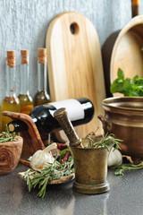 Vintage kitchen utensils with bottles of olive oil.