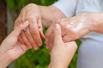Holding hands, Parkinson disease