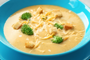 Plate with broccoli cheddar soup, close up