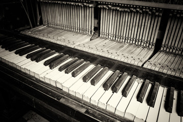 Keys from an old broken damaged piano