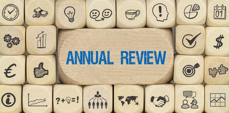 Annual Review / Würfel mit Symbole